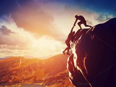 Hikers climbing on rock at sunset by Photocreo Michal Bednarek on Creative Market