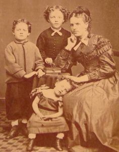 17 Haunting Post-Mortem Photographs From The 1800s.  Sometimes the facial expressions on some of the family members suggest they were upset or resentful about posing in the photo. The mother hear is an example of that, to my eye.