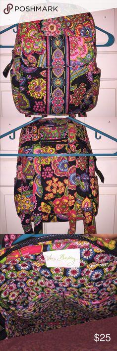 Vera Bradley small backpack. Symphony in Hue Vera Bradley small backpack. Retired Symphony in Hue pattern. Adjustable straps. Front outside pocket. Open pockets on side. 2 slip pockets on inside. Zippered back pocket. Vera Bradley Bags Backpacks
