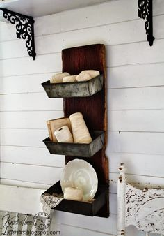 """Being snowed in for the last several days has given me lots of time to be productive and I've brought home bunches of """"stuff"""" from auctions & thrift stores recently, including a plank of antique barn wood and a bunch of antique bread pans. I love turning bread pans into wall bins, and the barn wood was the perfect backing to connect them to. It is classic barn red, and the wood is wonderfully aged. I love the """"folded"""" edges {Read More}"""