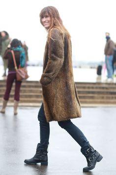 Caroline de Maigret in tough-girl boots a luxe fur coat. #streetstyle at Paris Fashion Week Fall 2014 #PFW