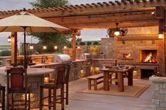 barbecue extérieur avec un coin repas et bar