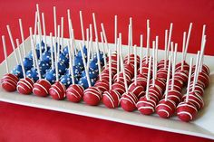 I would do 4 in the blue with star sprinkles (or dots of white chocolate), then alternate rows of red with white stripes and white with red stripes.