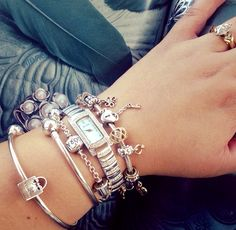 RECOMMEND: DZ loves the idea of charm bracelets for me. Thank goodness considering how many Pandora bracelets I own. Example of stacking w/ silver and gold. Pandora Bangle Bracelet, Pandora Rings, Pandora Jewelry, Pandora Charms, Charm Bracelets, Bracelet Designs, Unique Jewelry, Silver, Cheap Pandora