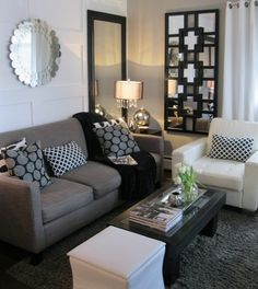 Amazing black, white and gray living room!  The best part is that these homeowners were able to maintain a similar look throughout the entire house, so it's all really cohesive.