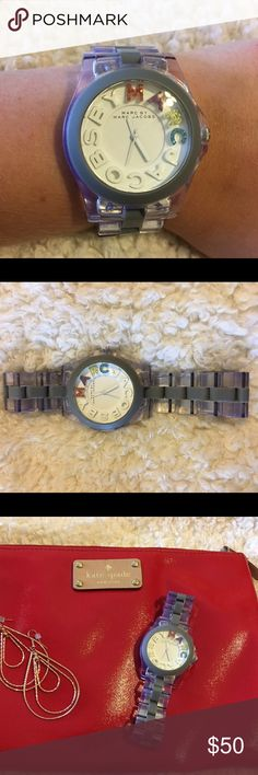 Marc Jacobs Clear Watch with color logo Used with some scratches, but still a beautiful watch! Perfect neutral Watch with fun watch face! This listing is for the watch. Marc Jacobs Accessories Watches