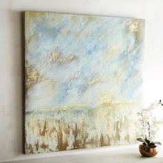 Escape to wide open spaces via our abstract painting. Filled with glowing golds, cool blues and wispy whites, it evokes a light breeze drifting in from the plain. With studied brushstrokes that create the appearance of movement.