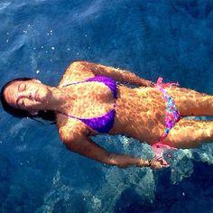 Bikini-clad Bar Refaeli cooled off in a swimming pool. (PopSugar)