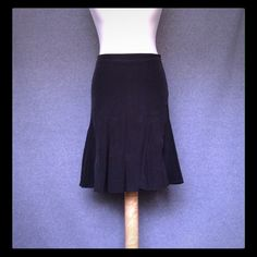 """GAP Silk Fluted Skirt GAP silk fluted skirt. Fitted in waist and hips then flares out to feel flowy around the thighs. Fully lined. Color is black. Materials are pure silk with polyester lining. Size 1 - fits between 26/27 waist (measures 22"""" from waist to hem). Brand is GAP. In excellent/pristine condition: no snags, tests, or stains. GAP Skirts"""