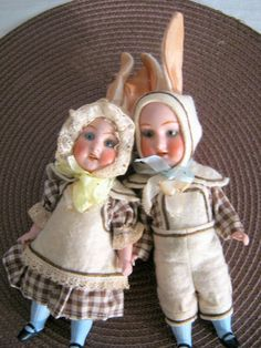 Two bisque rabbit dolls/bunnies /boy and girl /glass eyes/Hertwig/Germany