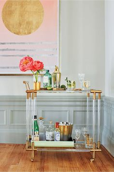 gorgeous bar cart and modern artwork in the living room