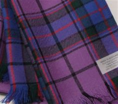 Beautiful wool Tartan scarf in shades of purple.