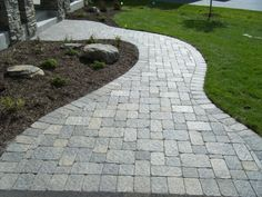Charlston Brick Paver Sidewalk with Flares leads from the Driveway to the Entry of this Eden Prarie home. Description from prideandjoylandscaping.com. I searched for this on bing.com/images