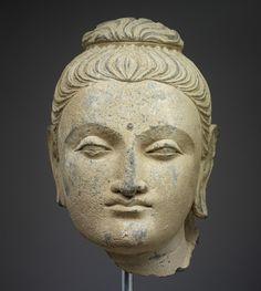 Unknown artist, Gandharan, Gandhara. Head of Buddha Shakyamuni, 1-200 CE. Gray schist/RISD Museum.
