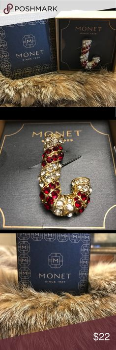 Monet Candy Cane Brooch🎁Glamorous Vintage & New! Rhinestones and Sparkle ladies! New in original box (Has never been removed from its packaging)  Rollover type clasp which closes securely  A fabulous Holiday Gift or a wonderful addition to your designer collection. Monet Jewelry Brooches
