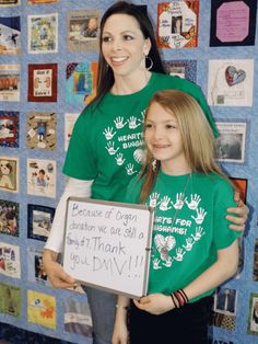Lisa Britton/ For the Baker City Herald Stacy Bingham, left, and her daughter, Lindsey, attend an event Wednesday honoring the Oregon DMV for encouraging people to register as organ donors. Lindsey had a heart transplant on Feb. 14, 2013.