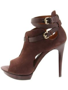 Wondering what to pair with your fall shorts suit? Um, these cut-out, peep-toe brown booties. Hands. Down. Pelle Moda Women's Famous Ankle Boot, $135.96, endless.com