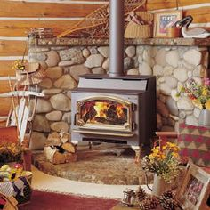 beautiful river rock hearth for wood stove