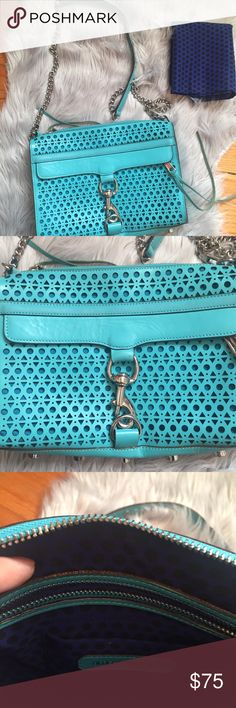 Rebecca Minkoff Blue Perforated Crossbody Rebecca Minkoff Blue Perforated Crossbody. Silver accents. Used a few times but in great condition. Small wrinkling in front flap (pictured). This style no longer available anywhere! Enjoy! Garment bag included. Rebecca Minkoff Bags Crossbody Bags