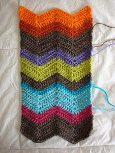 A reader requested the pattern for the chevron scarf that I'm still working on So here it is MaterialsSize G or H crochet hook (the H hook will make a looser and wider scarf)worsted weight yarnYarn n