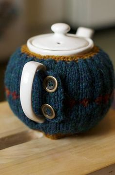 Hand Knitted Teapot Cosy with brass buttons.    via amorningcupofjo:    (Camilla Hoel)  Beautiful colors :)