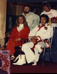 Elvis and Linda watching Kang Rhee's exhibition.