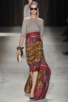 Dries Van Noten, RTW Spring 2010. Beautiful, An outfit that could live in your closet for a long time. Is it a super-classic or was van Noten amazingly advanced in 2010?. (P.S. The defined waist may mean it's not for me, but wraps can be incredibly flattering depending on how they fall. I'd definitely try it on with a sweater that hangs very slightly over the waistline rather than tucked in.)  Photo: Imaxtree  Prev Next Play Slideshow 8 of 53 Rate this Look HITMISS Top 100  Dries Van…