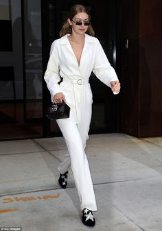 Fancy: Gigi Hadid dressed up in a chic white jumpsuit that showed off her slim waist in Wednesday in New York City