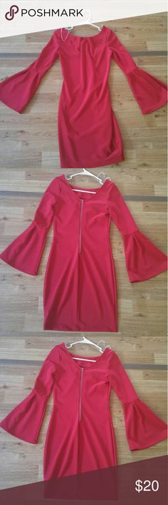 Mystic red dress This dress is a beautiful piece of clothing. It is form fitting that shows off a woman's cuves. It has a zipper half way down the back that really makes the dress pop. Mystic Dresses Long Sleeve