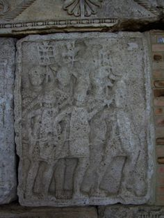 Adamclisi Metope. Marching Legionaries with standard bearers in the background.