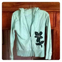 Lightly pre-loved light blue hooded zipsweatshirt Lightly worn/used light blue sweatshirt. Has a front zipper and string tie hood. NO POCKETS THOUGH. NO RIPS OR TEARS. However there is a barely noticeable, small stain near the right under arm (looks like it could be removed with some kind of cleaner though). 100 percent cotton. Just trying to clear out my closet Maurices Jackets & Coats