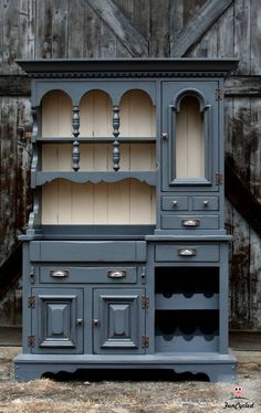 Antique cupboard: This antique hutch is so beautiful and unique… I've never seen a hutch like it. It's been painted a stunning grey (Benjamin Moore's Anchor Grey). The left bottom section of the hutch drops down like a dry bar with original black faux stone. It has a custom made wine rack on the bottom right as well.