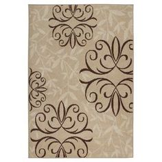 Woven indoor/outdoor rug with a medallion and leaf motif.  Product: RugConstruction Material: PolypropyleneColor: Tan and brownFeatures:  Made in the USASuitable for indoor or outdoor use  Note: Please be aware that the actual colors may vary from those shown on your screen. Accent rugs may also not show the entire pattern that the corresponding area rugs have.Cleaning and Care: Vacuum regularly. Professional cleaning recommended.