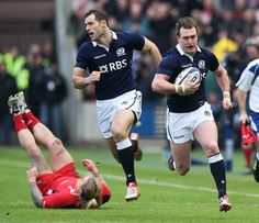 Scotland's Stuart Hogg races away for their first try