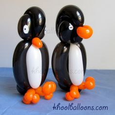 Penguin balloon animals. I HAVE to learn how to do this for monster's first birthday!!!
