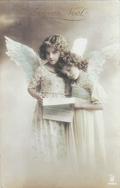 Two Angels in sepia tone photo.