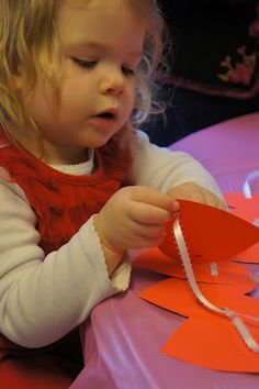 Heart Garland stringing activity for toddlers.  Great Fine Motor practice!!!  @Mommy and Me Book Club