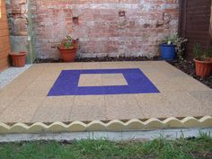Garden patio using our highly permeable paving slabs
