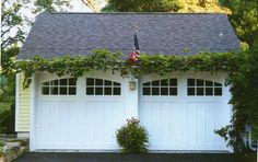 carriage #garage door | More here: http://mylusciouslife.com/stylish-home-luxury-garage-design/