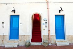 In blue & red by Luca Bonisolli - Photo 44116168 - Book Stairs, The Doors Of Perception, Painted Doors, Shades Of Blue, All The Colors, Entrance, Windows, Creative, Red