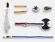 Designer Bryan Ku's playful take on the classic pillow fight–pillows with silkscreened images of weapons.