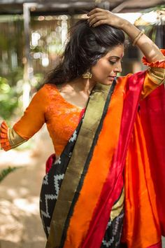 Buy House Of Blouse Orange ikat raw silk blouse online in India at best price.ove for tangerine orange is never lost, especially during the festival of lights and colors. Saree Blouse Patterns, Saree Blouse Designs, Saree Styles, Blouse Styles, Indian Attire, Indian Outfits, Indian Dresses, Ethnic Fashion, Indian Fashion