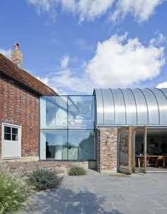 Let me introduce you to a beautiful extension of an old farmhouse in south-east England: Hawthbush Extension. A distinctive detail turn this simple building into a contemporary tribute to traditional architecture by using a barrel-vaulted roof that references local agricultural buildings. As you can see, an ingenious effort was developed to embrace different times, scales …