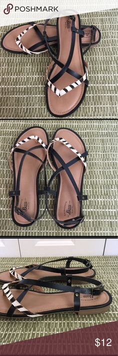 Bass Black/White patterned sandals Bass black  with white/black patterned straps.  Black straps are leather and patterned straps are man-made materials.  These are new and have not been worn.  Very cute to dress up or dress down. Bass Shoes Sandals