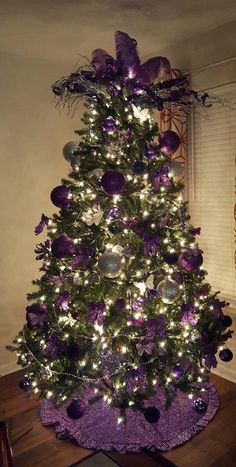 violet christmas tree love the feather topper and the ruffled tree skirt so unabashedly feminine - Purple And Gold Christmas Tree Decorations