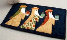 Three Kings Christmas Mug Rug. All that glistens is gold ..... thread!   Gifts abound here - the Kings are carrying them and the gowns they are wearing are made from a Moda 'Round Robin' charm pack that was given to me for Christmas.