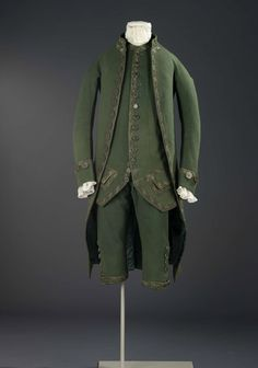 I like the bling of 18th century suits, but sometimes under-stated elegance is the way to go. This suit is lacking the flashiness of some 18thc suits I've featured here, but it's still of very high quality.Made of wool with metal thread and gorgeous buttons. This is a good example of an English coat of the 1770s & 1780s.