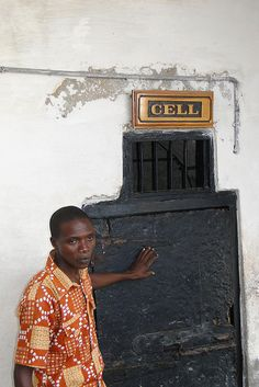 Guide by Entrance to Slave Cell - Cape Coast Castle - Cape Coast - Ghana by Adam Jones, Ph.D. - Global Photo Archive, via Flickr