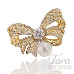 Beautiful Pearl and Diamond Brooch, 18k yellow gold, 12.6 grams. Nostalgic design features 11.3mm South Seas pearl set with diamonds, 1.01tdw.  Tara Fine Jewelry Company, Atlanta.