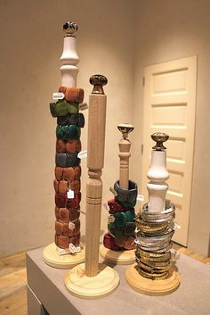 Bracelet holder? Could take an old paper towel holder, paint it, and put glass knob on top?